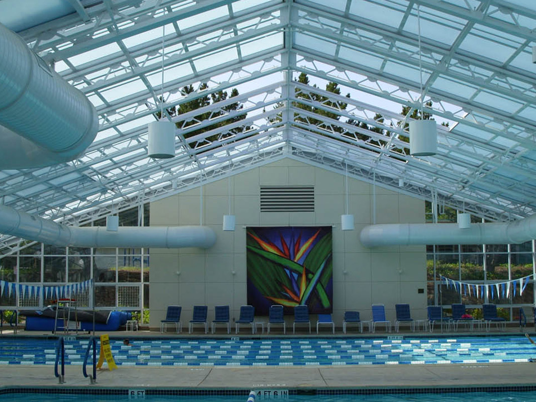 OpenAire's retractable roof over the pool at Rossmore Community Center in Walnut Creek, California.