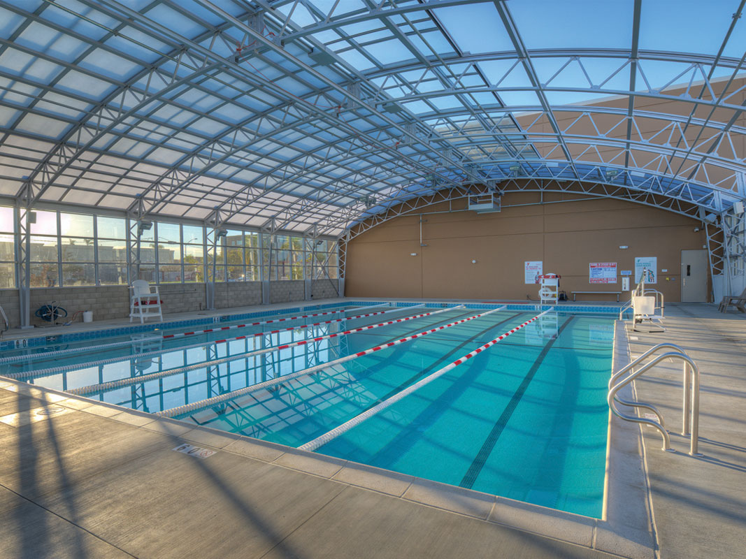The top reasons why retractable swimming pool enclosures bring year round benefits openaire for Disadvantage of indoor swimming pool